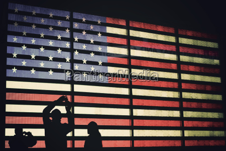 people photographing illuminated american flag times