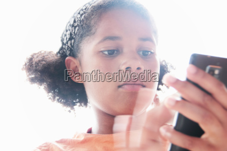 close up of girl using cell