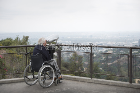 senior man in wheelchair looking at