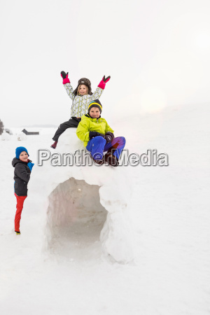 two children sitting on top of