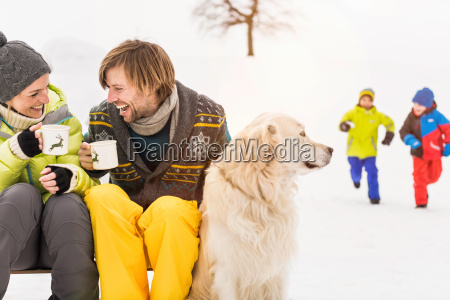 man and woman with hot drinks