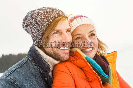 portrait of couple wearing knit hats