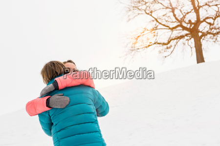 mid adult couple embracing with bare