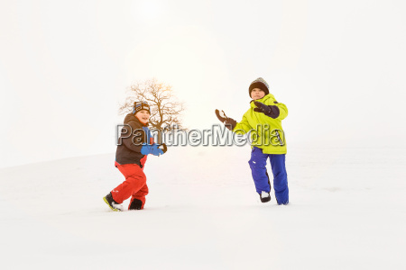 two boys playing in snow