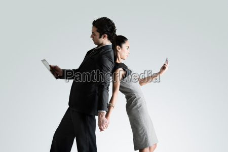 business couple using cell phone and