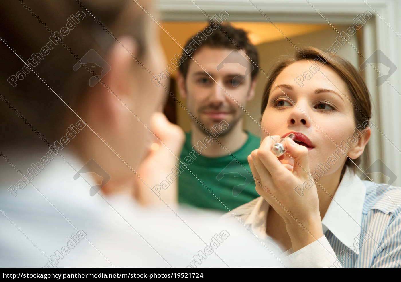 young, woman, applying, lipstick, in, bathroom - 19521724