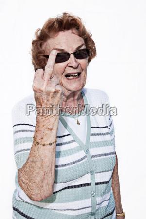 portrait of a senior woman making