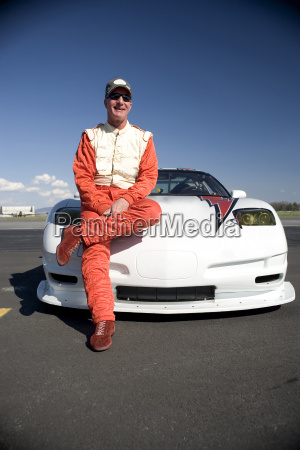 portrait of mature male racing car