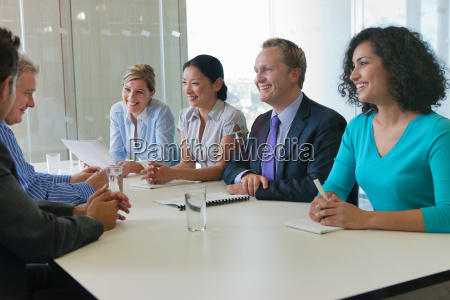 office workers smiling in meeting in