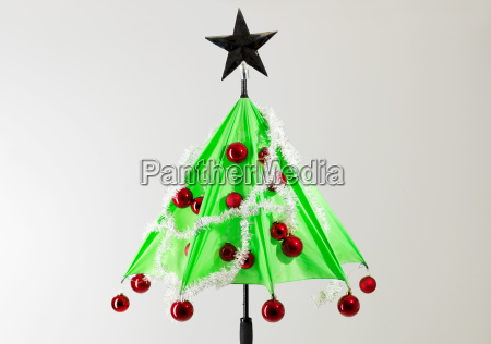 green umbrella with christmas decorations against