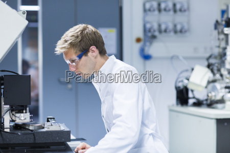 male scientist monitoring equipment in laboratory