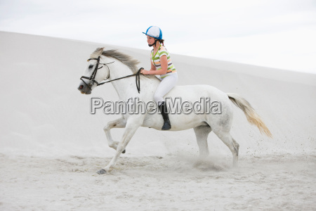 young girl riding horse on the
