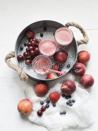glasses of fresh fruit smoothies with