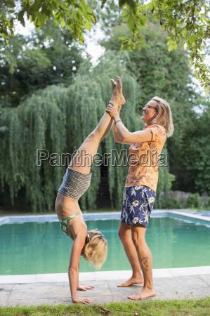 couple having fun by pool