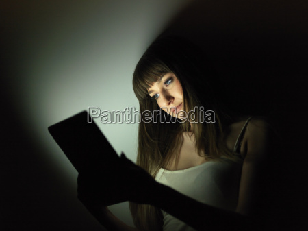 young woman using digital tablet at