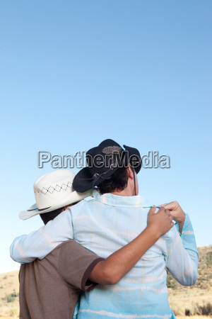 mother and son in cowboy hats