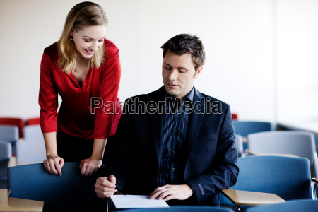 man and woman working on a