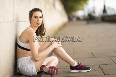 portrait of young female runner sitting