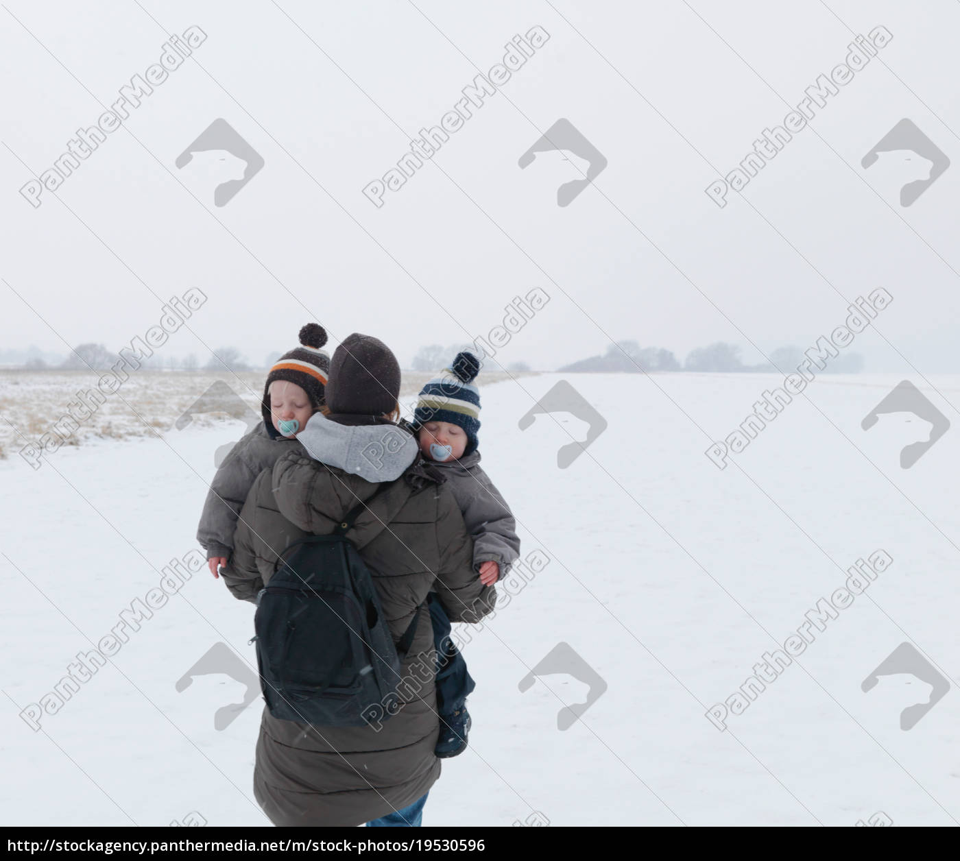 woman, walking, with, twin, sons, in - 19530596