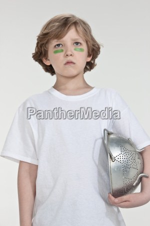 boy pretending to be soldier