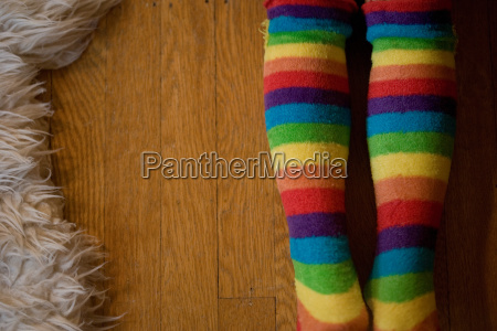 young girl wearing stripey tights