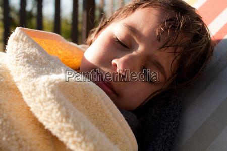 girl wrapped in towel sleeping