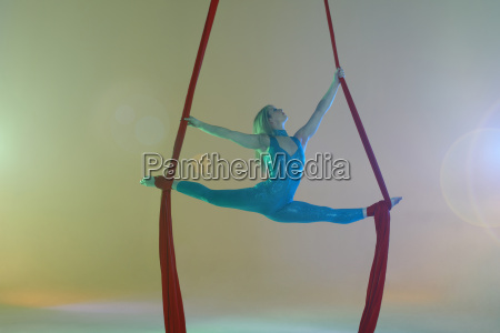 aerial dancer doing the splits with