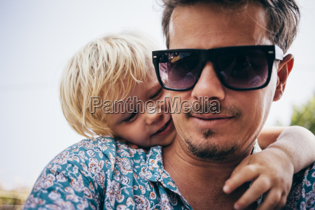 portrait of father with son wearing