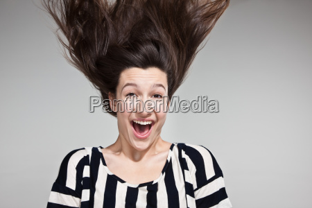 teenage girl with windswept hair