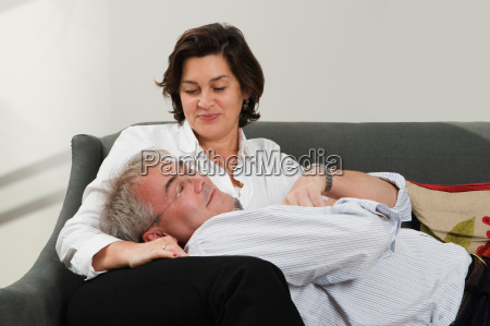 man, resting, head, on, wife's, lap - 19534058