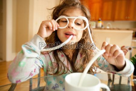 girl wearing pair of drinking straw