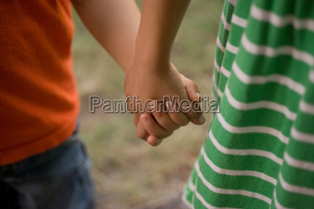 girl and boy holding hands close