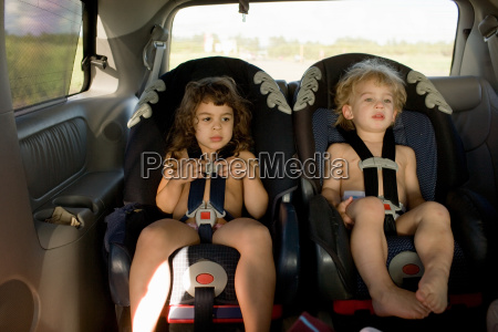 brother and sister sitting in car