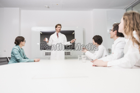 man wearing lab coat standing at
