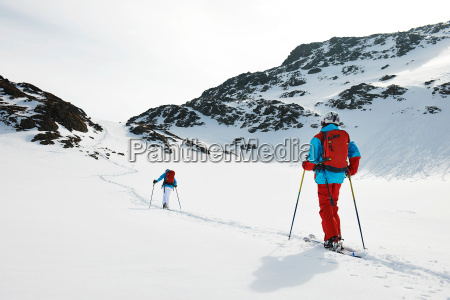 skiers walking in snow kuhtai austria
