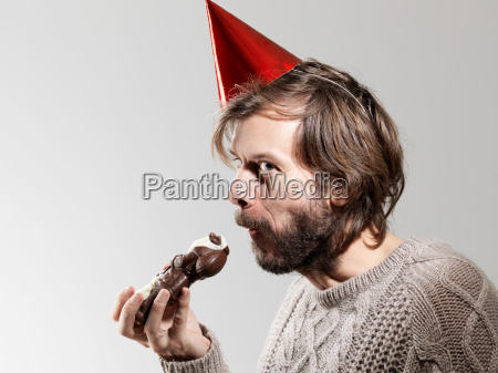 mid adult man in party hat
