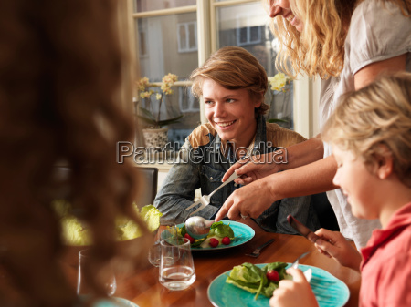 mother serving healthy meal to family