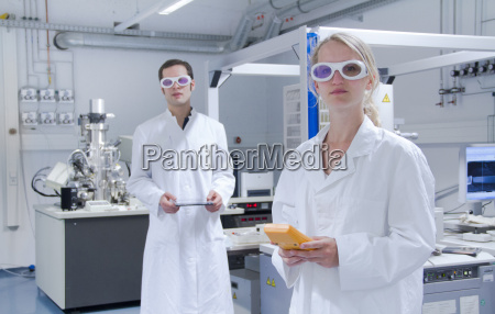 two scientists wearing lab coats and