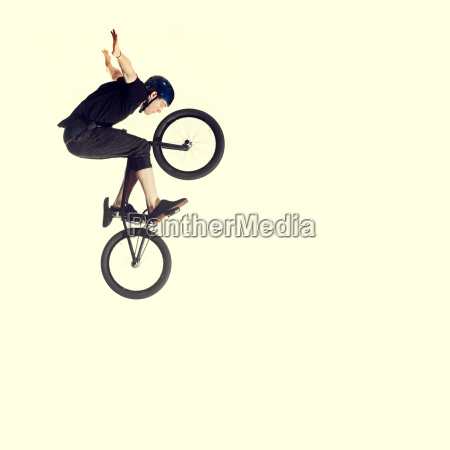 young man on bmx bike mid