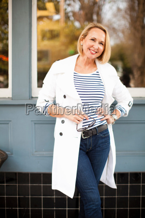mature woman in white coat and