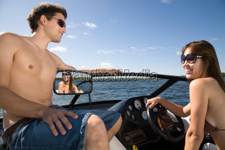 couple in speedboat on lake
