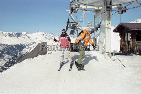 couple exiting chair lift