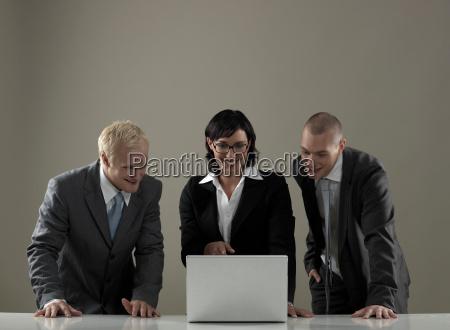 business men watching laptop