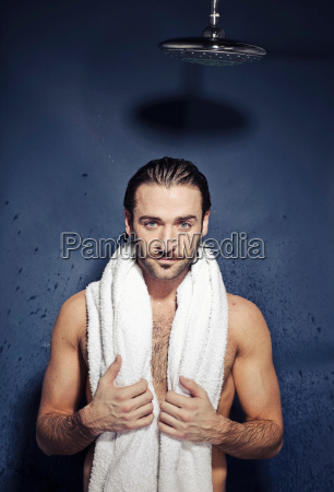 young man after shower with towel