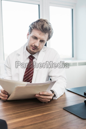 mid adult man sitting at desk