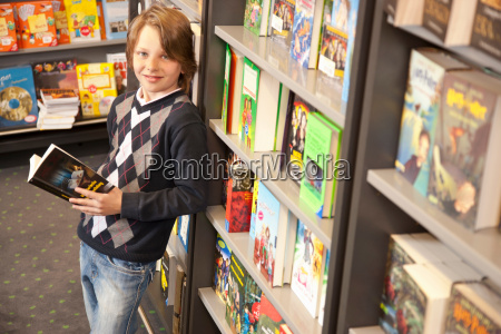 boy browsing books in the book