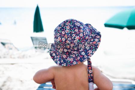 baby girl wearing sunhat st maarten