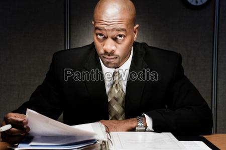 man at desk doing paperwork