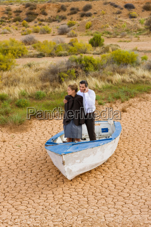 business couple lost in desert