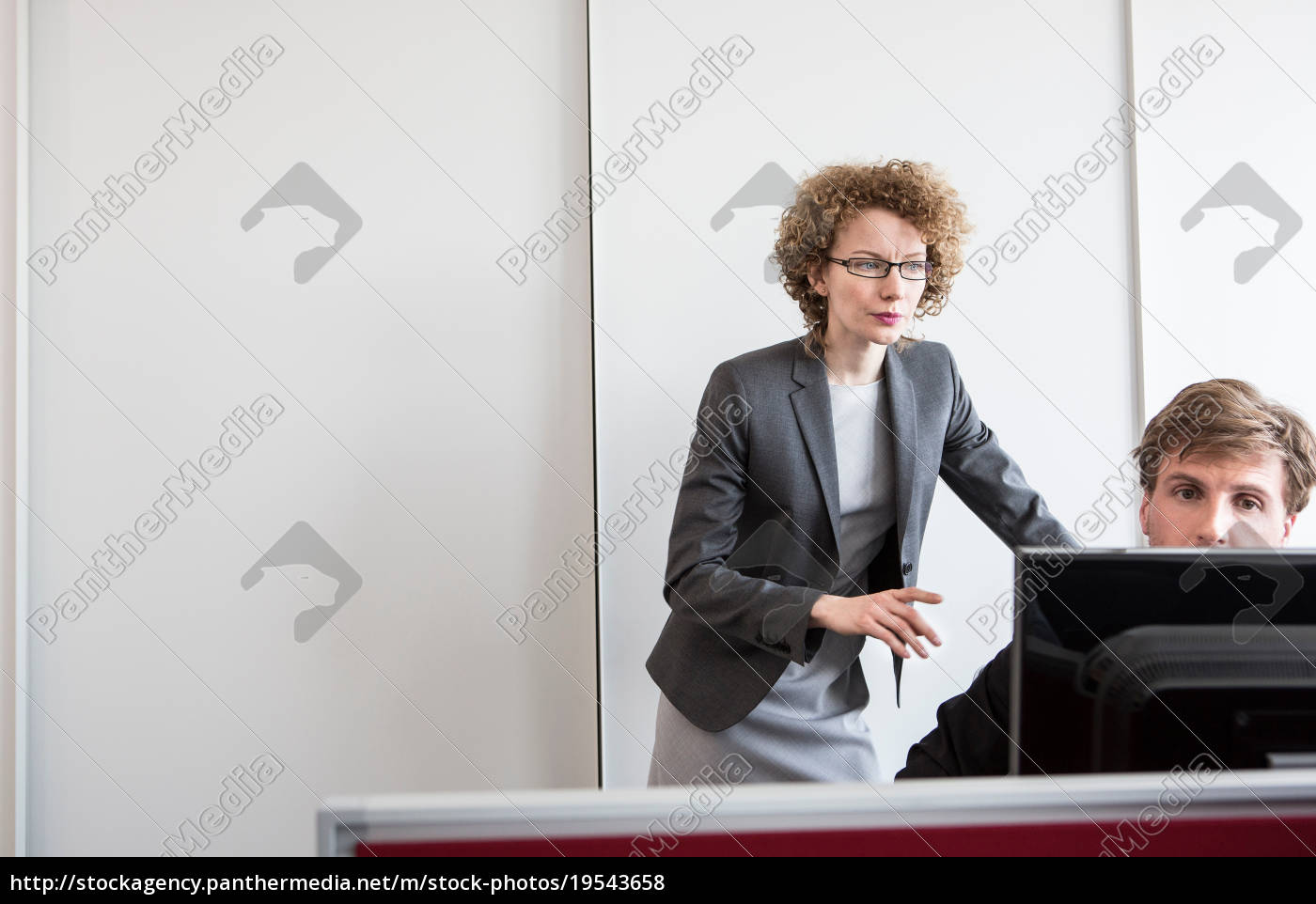 businessman, and, businesswoman, working, in, office - 19543658